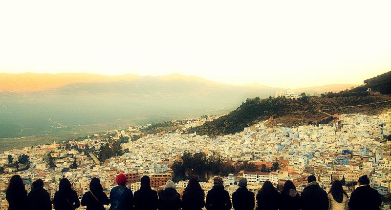 Friends reflecting at sunrise.Chefchaouen.